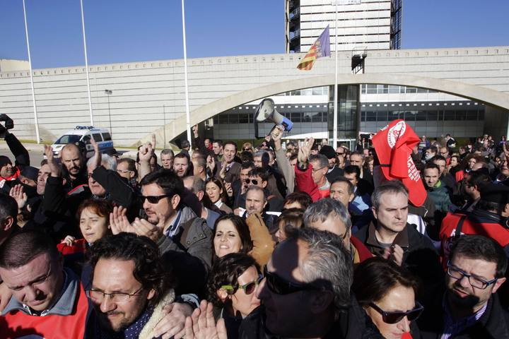 Employees of public broadcaster RTVV leave the station's headquarters after a court ruled to cut transmission and to evacuate from the building in Valencia